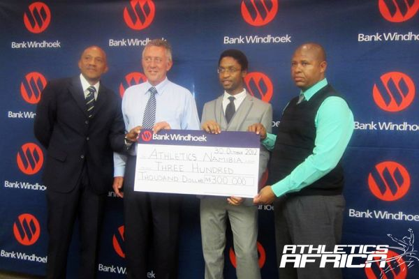 (L-R) Athletics Namibia President, Frank Fredericks, Bank Windhoek's MD Christo de Vries & others during the presentation/ Photo: AN