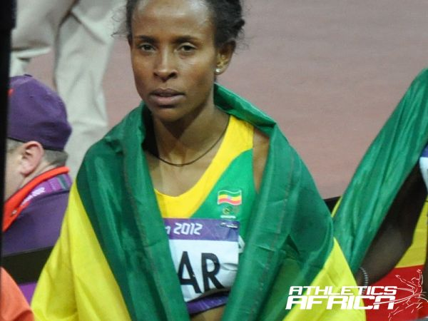 Meseret Defar walking away from the track after her winning celebration in London/ Photo: Yomi Omogbeja at the Olympic Stadium