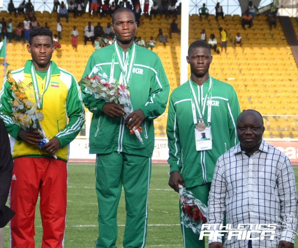 Governor of Delta State with the AYAC 2013 Boys 100m podium with Divine Oduduru in the centre / Photo: Segun Ogunfeyitimi