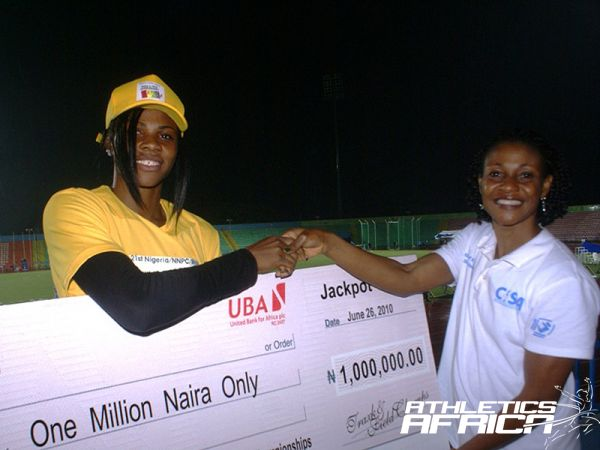 L-R: Passing the Baton - African sprint champion Blessing Okagbare receives a cheque from former African queen, Mary Onyali, at the All-Nigeria Championships in Calabar last year.