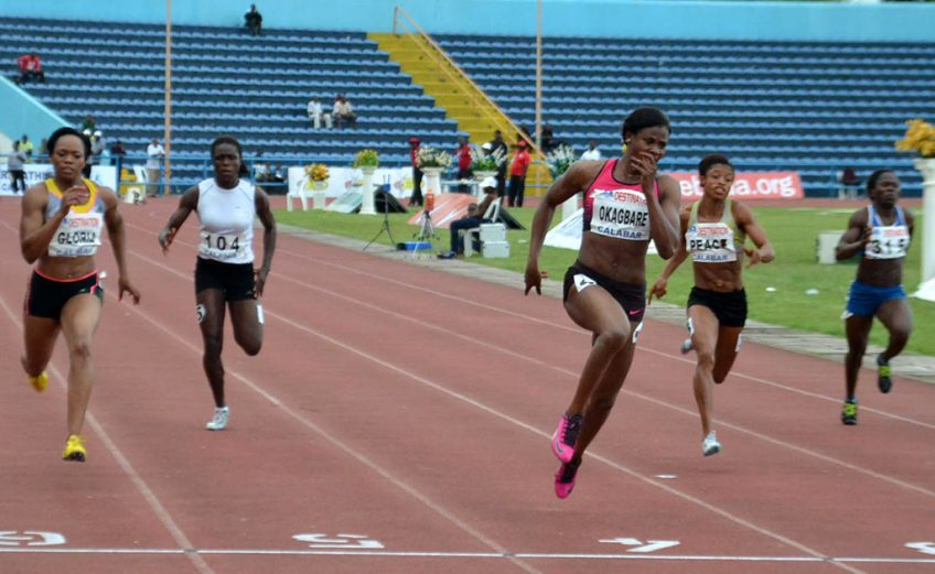 Blessing Okagbare winning the 100m race in Calabar 2013 / Photo: @Shengolpixs