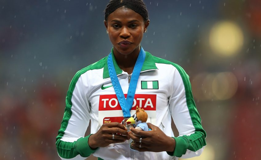 Silver medalist Blessing Okagbare of Nigeria on the podium during the medal ceremony for the Women's Long Jump final during Day Two of the 14th IAAF World Athletics Championships Moscow 2013 at Luzhniki Stadium on August 11, 2013 in Moscow, Russia. (Photo by Mark Kolbe/Getty Images)