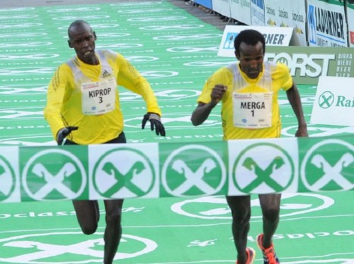 Wilson Kiprop and Imane Merga at the finish (Photo Credit: BOclassic/Danielle Mosna)