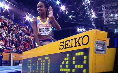 Ethiopia's Genzebe Dibaba smashes another world Indoor record, her third in 2 weeks, this time the 2-mile record at the British Indoor Grand Prix in Birmingham on Saturday.