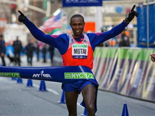 Geoffrey Mutai of Kenya crossed the finish line on Sunday to win the New York City Half Marathon. Credit Craig Ruttle/Associated Press
