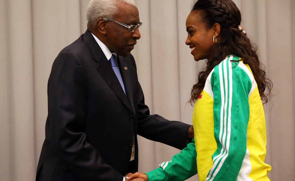 Lamine Diack (L), IAAF President greets Genzebe Dibaba of Ethiopia during a press conference prior to the IAAF World Indoor | Photo Credit: IAAF / Getty Images