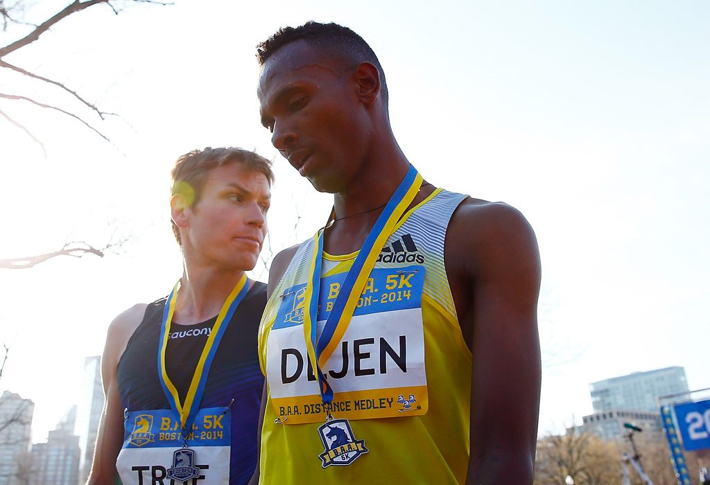 Dejen Gebremeskel of Ethiopia edged out Ben True (USA) for first place walk near the finish line of the 2014 B.A.A. 5K on April 19, 2014 in Boston, Massachusetts. (Photo by Jared Wickerham/Getty Images)
