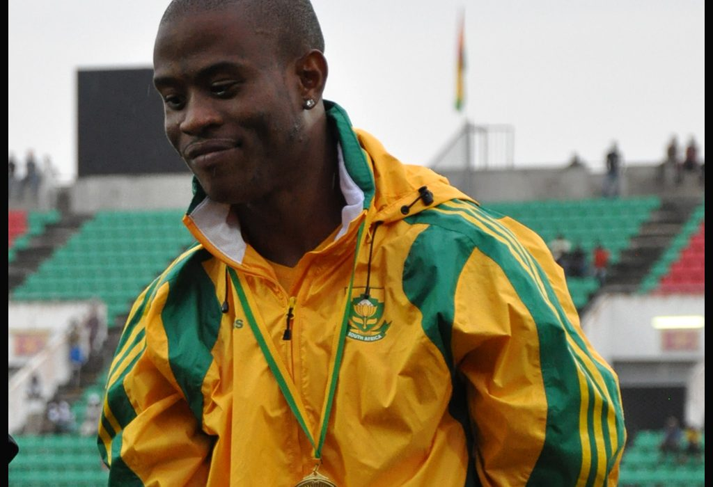 Simon Magakwe receiving his Gold medal after winning the men's 100m at the African Senior Championships 2012 in Benin / Photo credit: Yomi Omogbeja