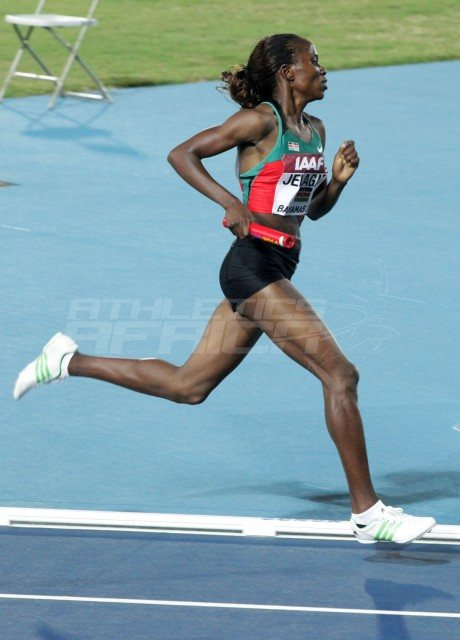 Kenya's women's 4x1500m star Irene Jelagat on the way to setting the World Record at Nassau 2014 / Photos credit: Derek Smith