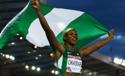 Nigeria's Blessing Okagbare celebrates after winning the women's 100m and clocking a 10.85 Games record.