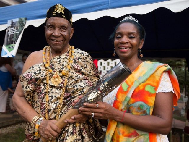 Ezekiel Cofie (93 years old), also known as Nii Kojo Ababio V, holds the Queen's Baton with his daughter Zetta Cofie, in Accra, Ghana, on Sunday 5 January 2014 / Glasgow 2014 OC Flickr