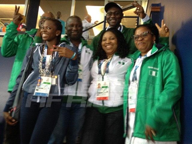 Hon Gbenga Elegbeleye, DG, National Sports Commission; his wife; the Technical Director of AFN, Commodore Omatseye Nesiama; and others celebrates with Ese Brume on her golden feat at the Hampden Park in Glasgow / Photo credit: Yomi Omogbeja