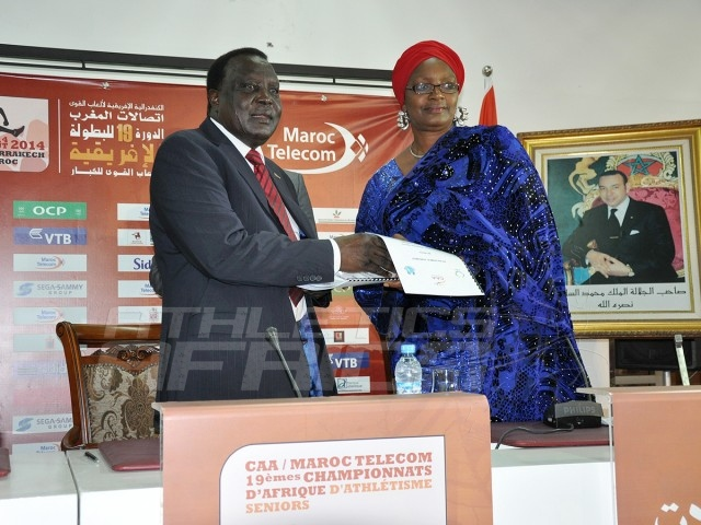 CAA President, Hamad Kalkaba Malboum presenting the signed Protocol agreement to Mrs Hauwa-Kulu Akinyemi, Director, Sports Planning Research and Documentation at the Nigerian Sports Commission, during the signing ceremony at the Grand Stade de Marrakech/Photo credit: Yomi Omogbeja