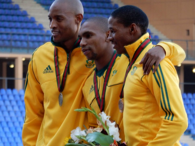 South African long jumper Zarck Visser, flanked by compatriots Khotso Mokoena and Rushwal Samaai, after winning the gold medal at the African Senior Athletics Championships in Marrakech, August 2014. / Photo credit: Yomi Omogbeja