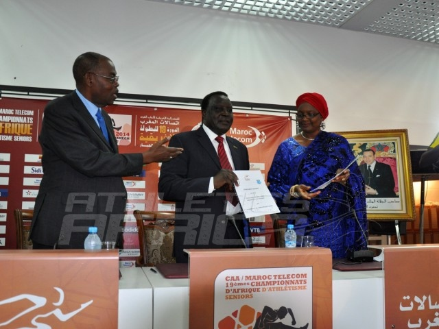 CAA President, Hamad Kalkaba Malboum displays the signed Protocol agreement, flanked by Mrs Hauwa-Kulu Akinyemi, Director, Sports Planning Research and Documentation at the Nigerian Sports Commission and CAA Vice President, Theophile Montcho, during the signing ceremony at the Grand Stade de Marrakech/Photo credit: Yomi Omogbeja
