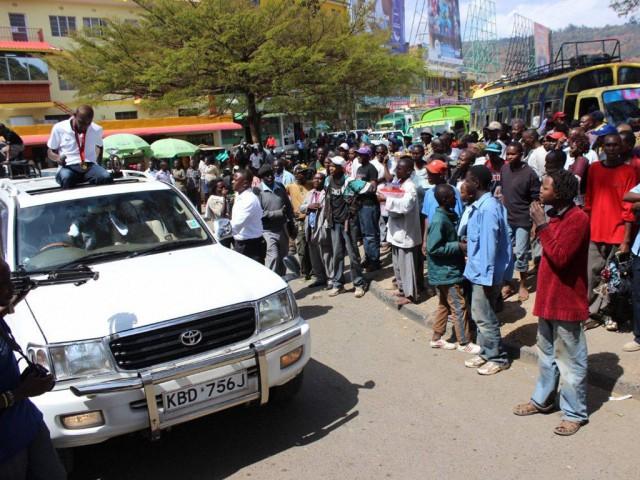 Caleb Mwangangi Ndiku waves to the crowd on his ultimate homecoming welcome party yesterday in Machakos, Kenya.