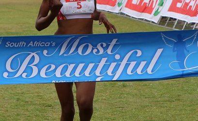 Lebogang Phalula celebrates her win as she crosses the finish line first at the SPAR Women's Challenge race in Johannesburg on Sunday, 12 October 2014 - Photo credit: Reg Caldecott