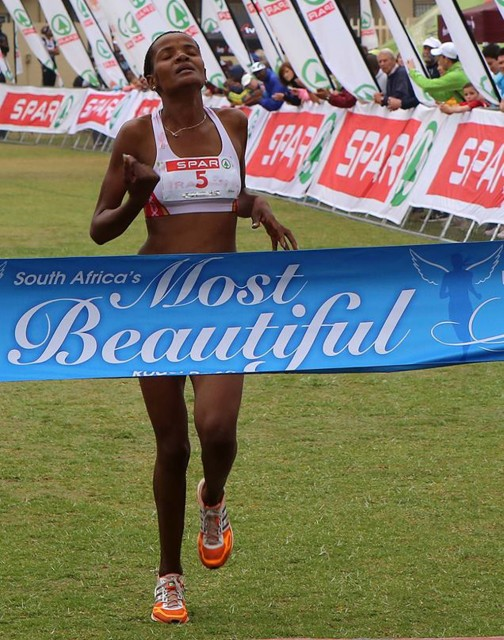 Lebogang Phalula celebrates her win as she crosses the finish line first at the SPAR Women's Challenge race in Johannesburg on Sunday, 12 October 2014 - Photo credit: Reg Caldecott