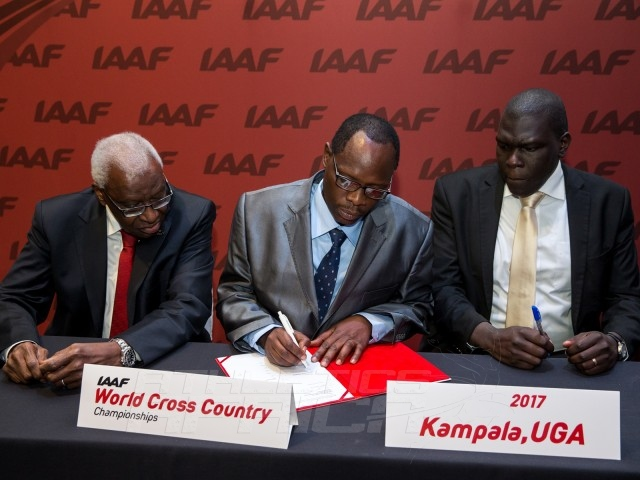 Ugandan delegation led by Hon. Charles Bakkabulindi, Honorary State Minister of Education and Sport signs the host city documents / Photo credit: IAAF / Philippe Fitte