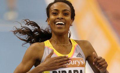 Genzebe Dibaba celebrates winning the women's two-mile contest at Birmingham's indoor grand prix
