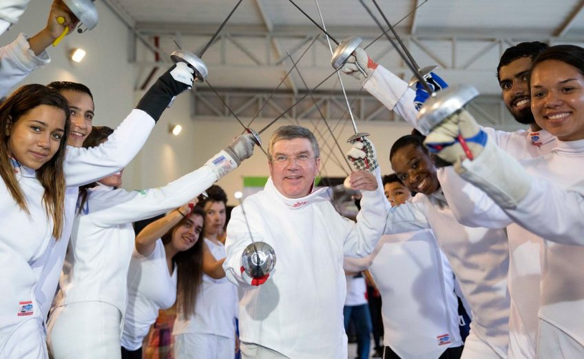 IOC President Thomas Bach with young Fencing athletes / Photo Credit: IOC Media Flickr