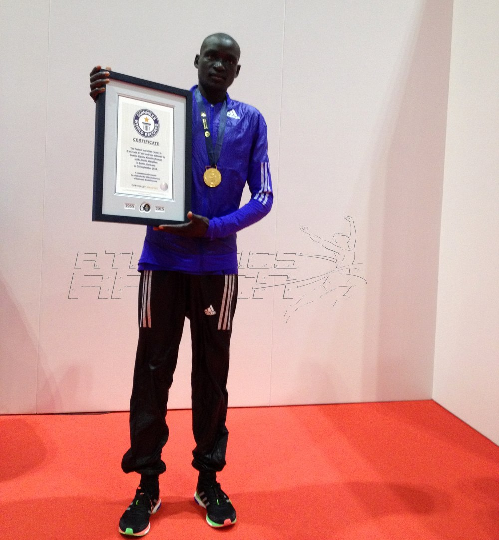 Dennis Kimetto with the official Guinness World Records certificate in London on Friday April 24, 2015 / Photo Credit: Yomi Omogbeja - AthleticsAfrica.Com