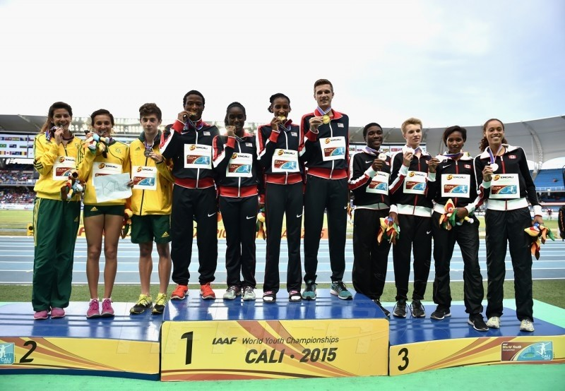 USA, South Africa and Canada celebrate on the podium after the Mixed 4x400m Relay on day five of the IAAF World Youth Championships, Cali 2015 on July 19, 2015 in Cali, Colombia. (Photo by Buda Mendes/Getty Images for IAAF)