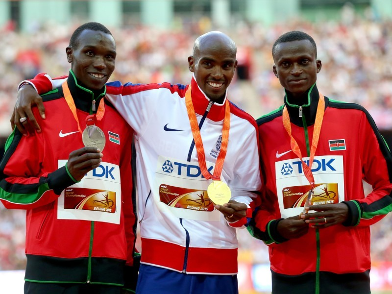 Kenyans Geoffrey Kamworor and Paul Tanui on the podium with Mo Farah during the award ceremony in Beijing / Photo Credit: Getty Images for the IAAF