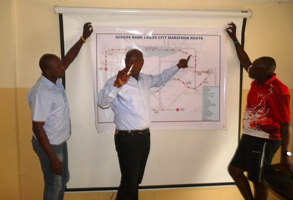 Yussuf Alli shows the Lagos Marathon route map to the media