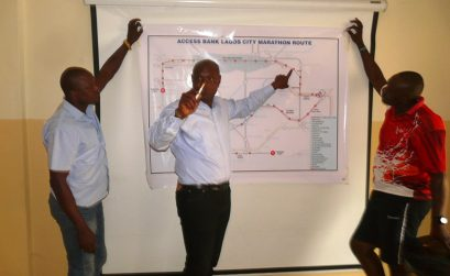 Yussuf Alli shows the Lagos Marathon route map to the media