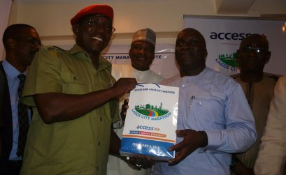 Nigeria's Minister of Youth and Sports, Solomon Dalung and Lagos State Sports Boss, Deji Tinubu at the Lagos City Marathon's office in Lagos on January 4, 2016 / Photo Credit: Organisers
