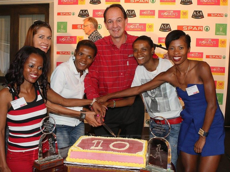 Left to Right; Poppy Mlambo (Athlete), Rene Kalmer (Athlete), Lebogang Phalula (Athlete), Mike Prentice (SPAR Group Marketing and/Merchandising Executive), Lebo-Diana Phalula (Athlete) and Mapaseka Makhanya (Athlete) pose as they prepare to cut the 10th YEAR SPAR GRAND PRIX Cake at the SPAR GRAND PRIX LAUNCH held at the Wanderers Sport Club on Wednesday 16 March 2016