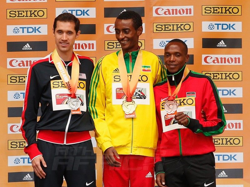 (L-R) Silver medallist Ryan Hill of the United States, gold medallist Yomif Kejelcha of Ethiopia and bronze medallist Augustine Kiprono Choge of Kenya during the medal ceremony for the Men's 3000 Metres during day four of the IAAF World Indoor Championships at Pioneer Courthouse Squareon March 20, 2016 in Portland, Oregon. (Photo by Christian Petersen/Getty Images for IAAF)