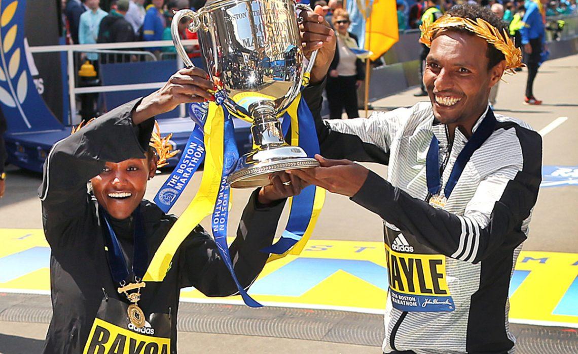 Ethiopian Lemi Berhanu Hayle edged defending champion Lelisa Desisa while Atsede Baysa beat a world-class field to win the 120th Boston Marathon