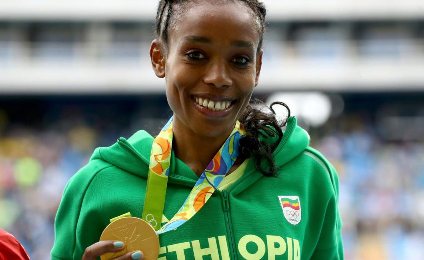 Ethiopia's Almaz Ayana with her women's 10000m gold medal on Day 1 of Athletics competition at Rio 2016 / Photo credit: Getty Images / IAAF