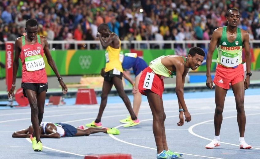 Paul Kipngetich Tanui of Kenya and Ethiopian Demelash after the men's 10,000 Final on day 2 at the Rio 2016 Olympics / Photo credit: Norman Katende