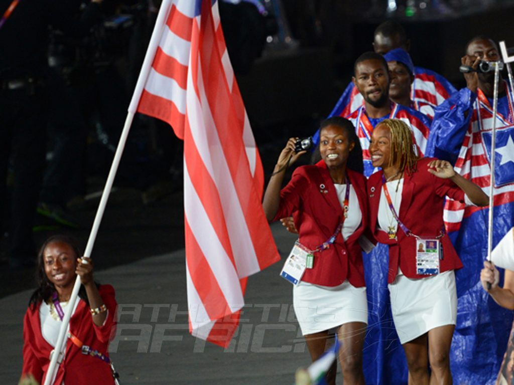 Phobay Kutu-Akoi carrying the Liberian flag at the Opening Ceremony of the London 2012 Olympics / Photo Credit: Phobay Kutu-Akoi