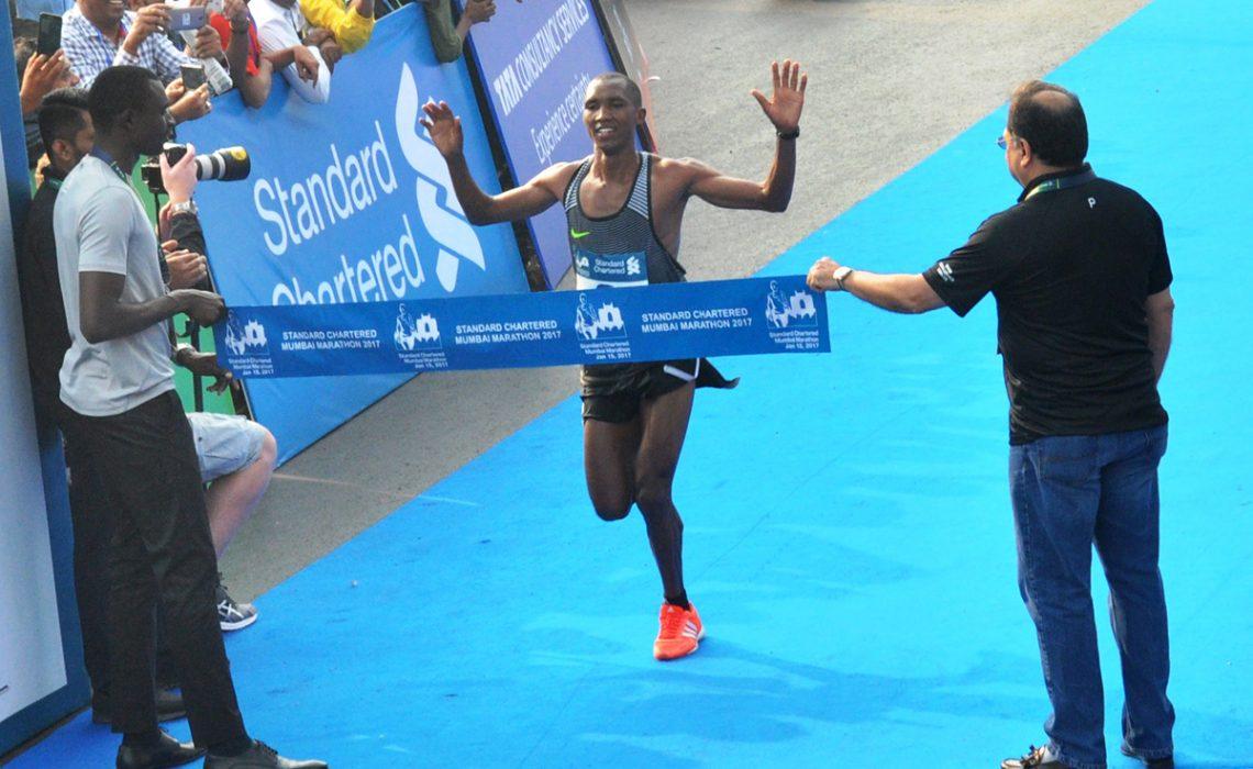 Tanzania's Alphonce Simbuwinning at the 14th edition of the Standard Chartered Mumbai Marathon 2017 / Photo credit: SCMM 2017 / Procam International