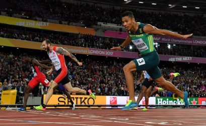 Turkey's Ramil Guliyev (C) crosses the finish-line ahead of South Africa's Wayde Van Niekerk (R) and Trinidad and Tobago's Jereem Richards (L) in the final of the men's 200m athletics event at the 2017 IAAF World Championships at the London Stadium in London on August 10, 2017. Photo Credit: AFP