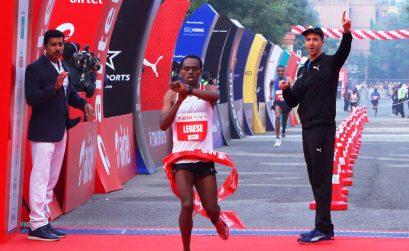 Ethiopian Berhanu Legese winning the Airtel Delhi Half Marathon 2017, an IAAF Gold Label Road Race / Photo Credit: Procam International