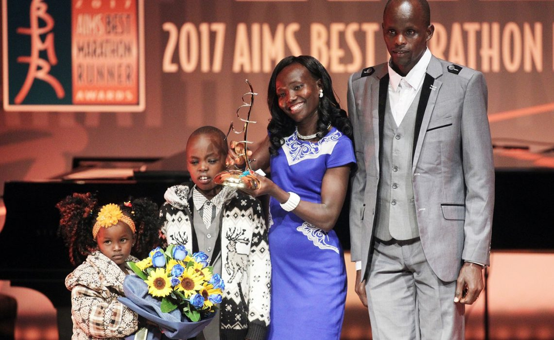 Mary Keitany with her family during the gala in Athens (photo credit: SEGAS-AMA)
