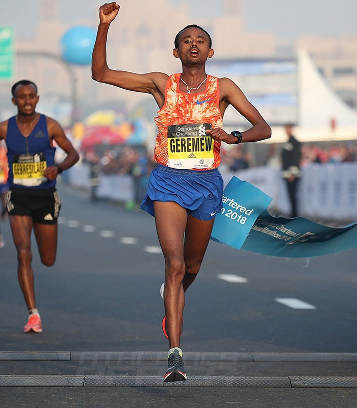 Ethiopia's Mosinet Geremew breaking the course record to take the men's title at the 2018 Standard Chartered Dubai Marathon / Photo Credit: Dubai Marathon Office