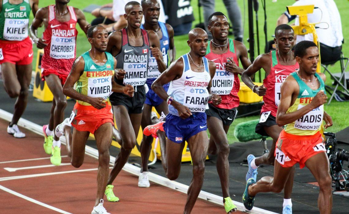 Jemal Yimer running alongside Mo Farah at the 10,000m World Championships final, London. Credit: Keith McClure