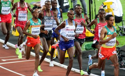 Jemal Yimer running alongside Mo Farah at the 10,000m World Championships final, London. Credit: Keith McClure