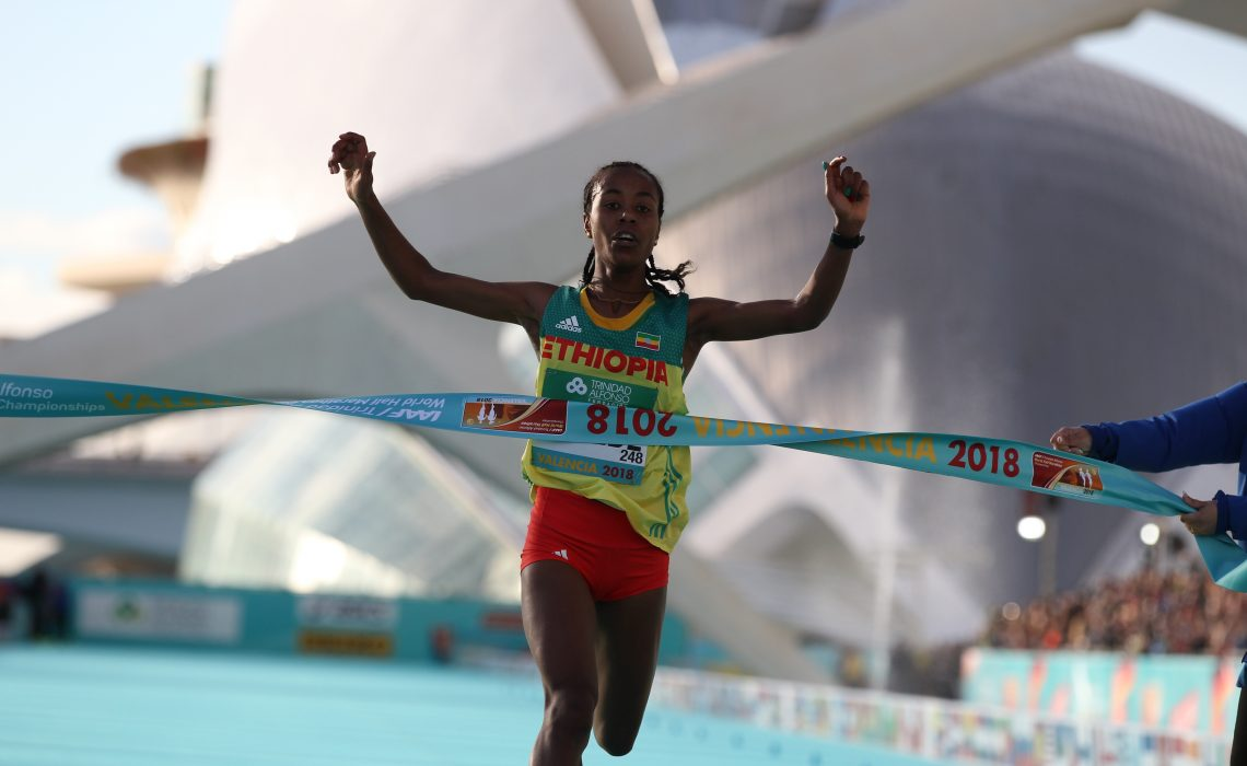Ethiopia's Netsanet Gudeta Kebede winning the women's race at the IAAF World Half Marathon Valencia 2018 / Photo credit: Jean Pierre Durand for the IAAF.