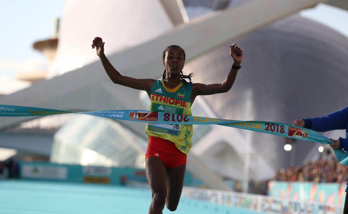 Ethiopia's Netsanet Gudeta Kebede winning the women's race at the IAAF World Half Marathon Valencia 2018 / Photo credit: Jean Pierre Durand for the IAAF.