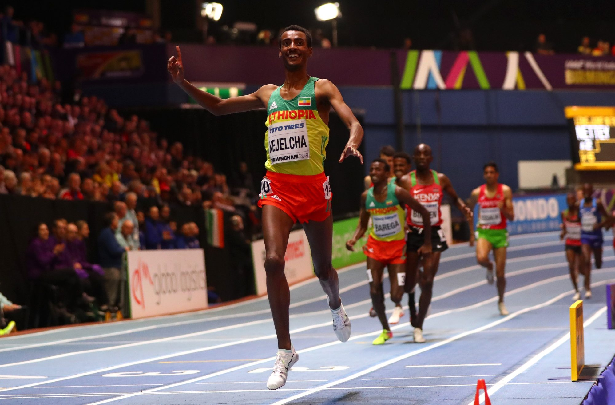 Gold Medallist, Yomif Kejelcha of Ethopia celebrates winning the Mens 3000 Metres Final during the IAAF World Indoor Championships on Day Four at Arena Birmingham on March 4, 2018 in Birmingham, England. (Photo by Michael Steele/Getty Images for IAAF)