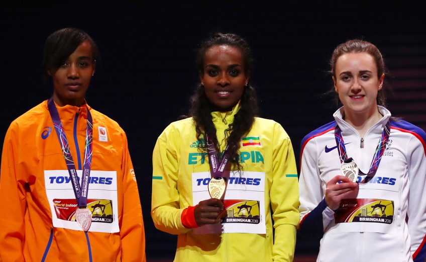 Genzebe Dibaba of Ethiopia celebrates winning the womens 3000 metres final ahead of Sifan Hassan of Netherlands and Laura Muir of Great Britian on Day One of the IAAF World Indoor Championships at Arena Birmingham on March 1, 2018 in Birmingham, England. credit: Photo by Michael Steele/Getty Images for IAAF
