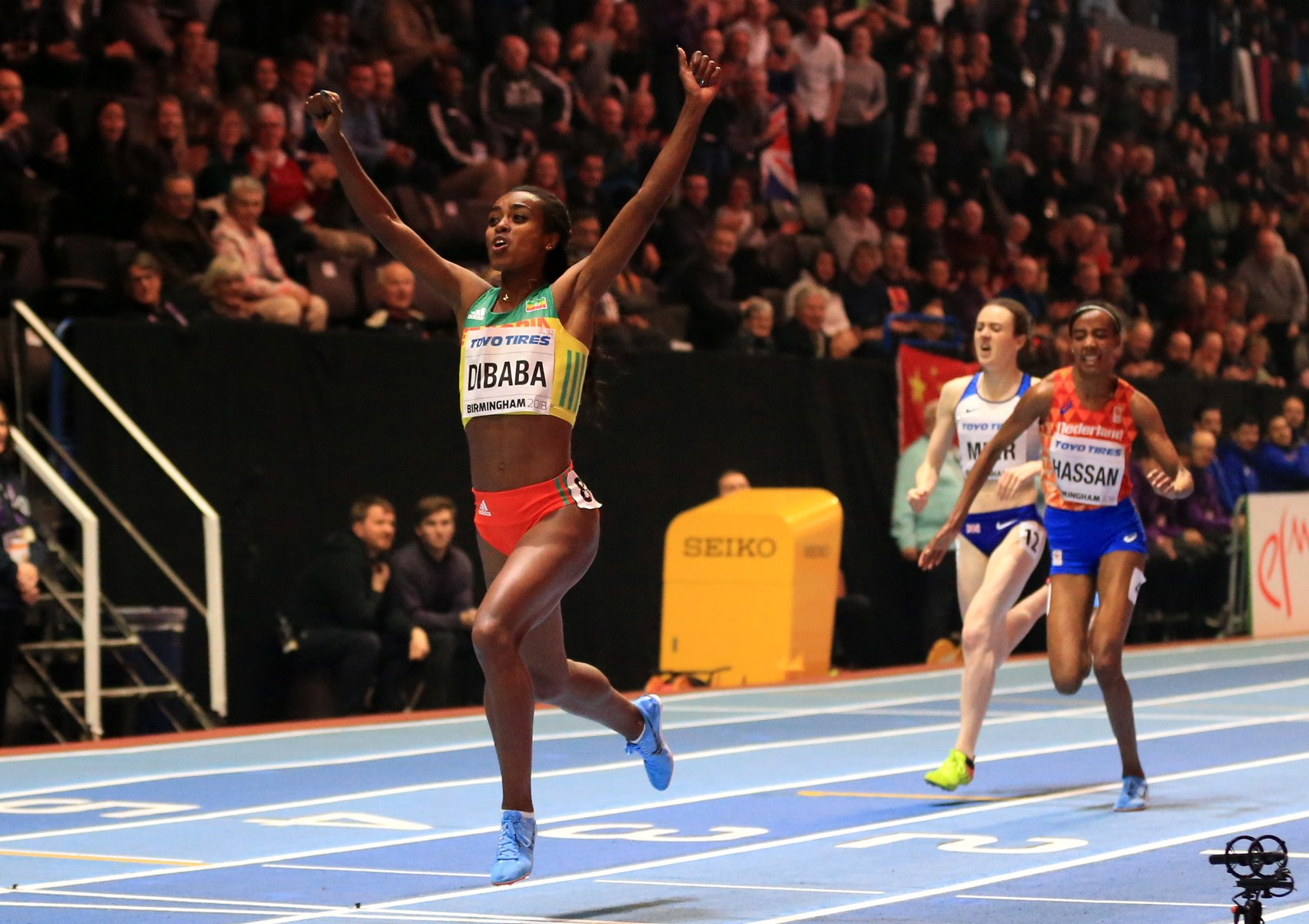 Genzebe Dibaba of Ethopia celebrates winning the womens 3000 metres final ahead of Sifan Hassan of Netherlands and Laura Muir of Great Britian on Day One of the IAAF World Indoor Championships at Arena Birmingham on March 1, 2018 in Birmingham, England. credit: Photo by Michael Steele/Getty Images for IAAF