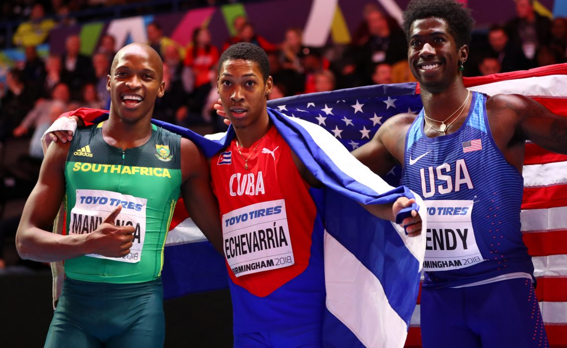 Juan Miguel Echevarria (C) of Cuba celebrates winning the Long Jump Mens Final with Luvo Manyonga (L) and Marquis Dendy (R) of United States during the IAAF World Indoor Championships on Day Two at Arena Birmingham on March 2, 2018 in Birmingham, England. credit: Photo by Michael Steele/Getty Images for IAAF